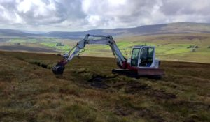 Peat restoration work taking place on Cam Fell