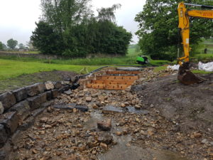 Hungrill weir fish pass during alteration work, the wooden baffles are clearly visible