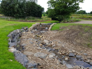The completed fish pass at Hungrill weir which will improve the           upstream reach of migratory fish